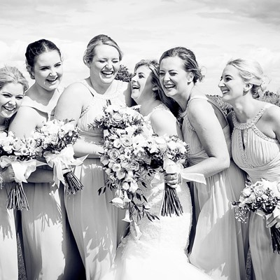 The bride & her bridesmaids enjoying themselves on the marquee lawn