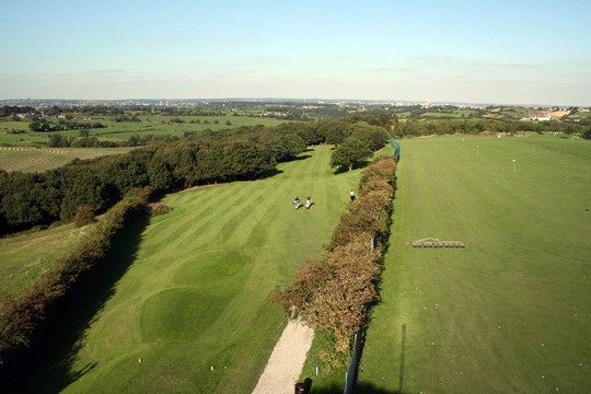 Tees on the 10th hole from above with driving range on the right