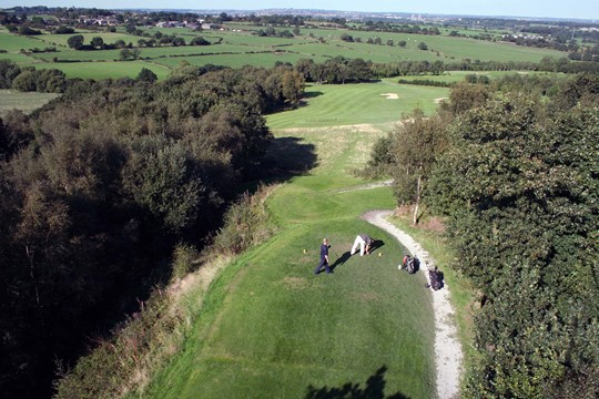 Tees on the 11th hole from above with stunning views of the countryside in the background