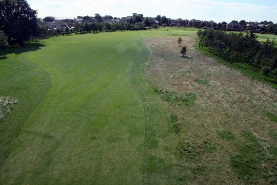 Looking down the fairway on the 16th hole from above.